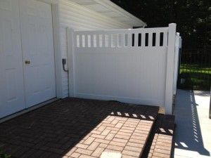 White Polyvinyl Privacy Fence Enclosure in Saugatuck, Michigan.