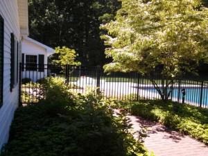 Aluminum Ornamental Fence Around A Beautiful Pool In Saugatuck, Michigan.