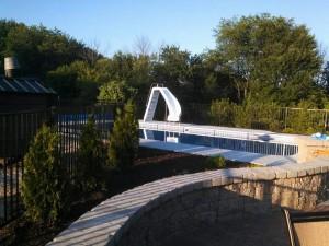 Two Rail Black Aluminum Ornamental Pool Fence in Lowell, Michigan.