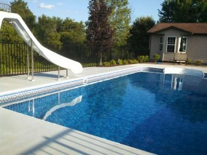 Two Rail Black Aluminum Ornamental Pool Fence in Lowell, Michigan.