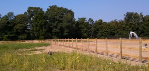 Three Rail Wood Horse Fence in Hamilton, Michigan