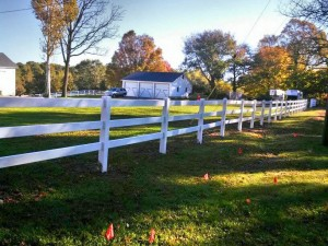 Three Rail Polyvinyl Horse Fence in Rockford, Michigan.
