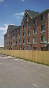 Custom Built, Treated Wood Fence, at the Best Western, in Grand Rapids, Michigan.
