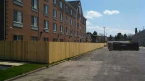 Custom built treated wood fence, dog eared style, at Best Western, in Grand Rapids, Michigan.