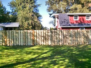 Custom Built, Treated Wood, Shadowbox Style, Wood Fence, in Hudsonville, Michigan.
