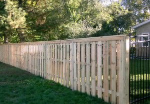 Custom Built, Treated Wood Fence, in Grand Rapids, Michigan.