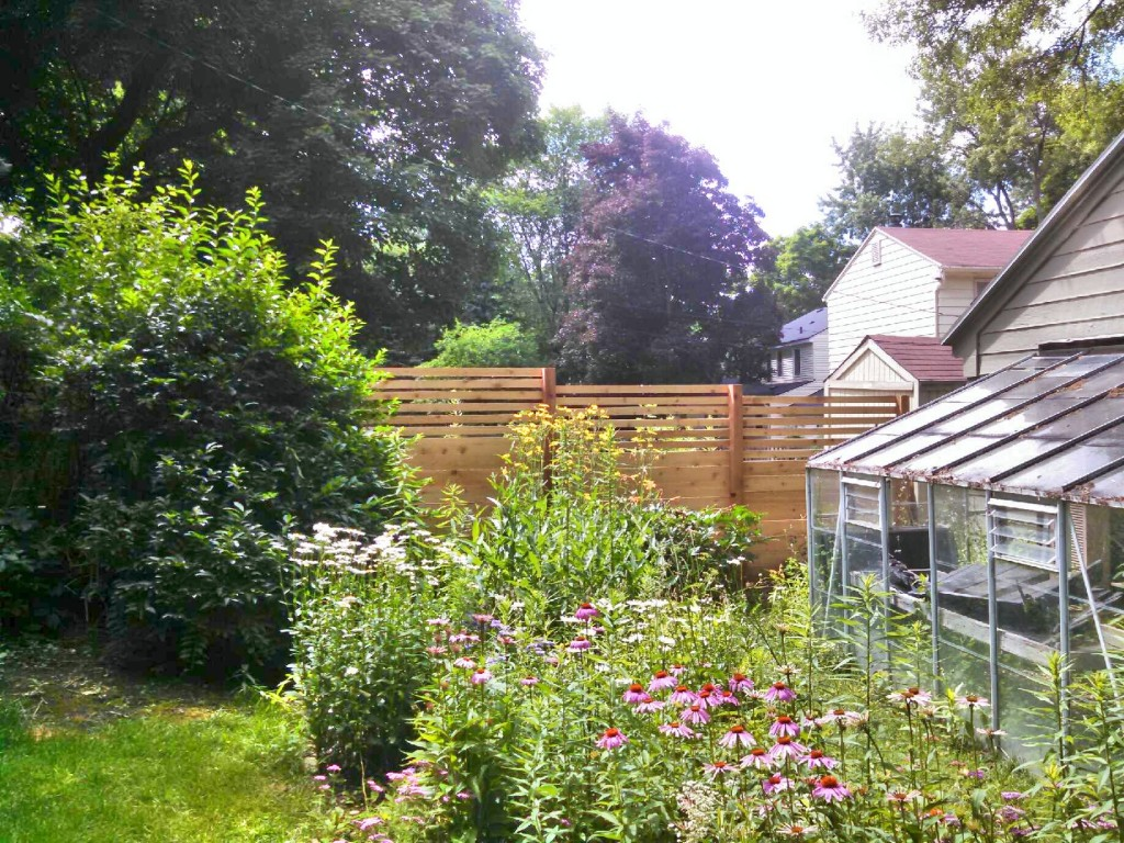 Custom Built Cedar Horizontal Privacy Fence in East Grand Rapids, Michigan.